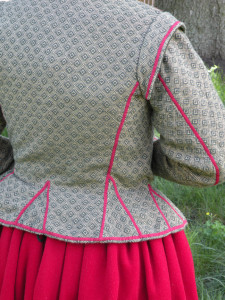 At the turn of the century, jackets like this one sat at the natural waist. As the 1600s became the 1610s and 1620s, the waistline rose to mid-rib.