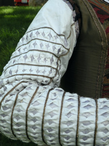 The sleeves of the kirtle were patterned after several pairs in Arnold's Patterns of Fashion and her article on Pinking and Slashing.